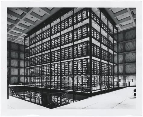 [Photograph of glass stack tower and books from mezzanine