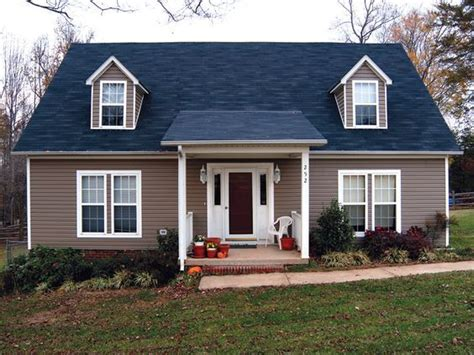 what house colors gowith a blue roof - Google Search